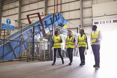 Staff wearing reflective vests in an industrial interior Royalty Free Stock Photos