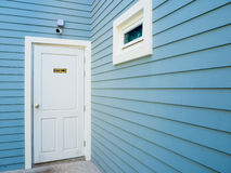 `Staff only` white door on blue wall Stock Photos