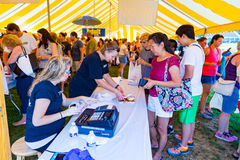 Staff at the Whoopie Pie Festival Tent. Ronks, PA - September 10, 2016: Cashiers tally the shopper's total at the Whoopie Pie Festival at Hershey Farms near Stock Photos
