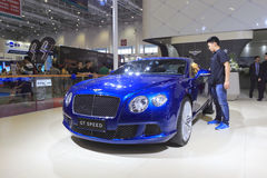 Staff wipe bentley gt speed car Stock Image