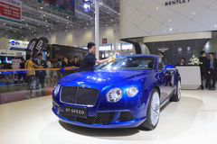 Staff wipe bentley gt speed car Royalty Free Stock Images