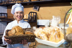 Staff working in bakery with bread Royalty Free Stock Photo