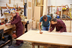 Staff Working In Busy Carpentry Workshop Royalty Free Stock Photo