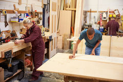 Staff Working In Busy Carpentry Workshop Stock Images