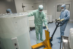 Staff working in clean area in the production site of the biotechnology company. ST. PETERSBURG, RUSSIA - NOVEMBER 16, 2016: Staff working in clean area in the royalty free stock images
