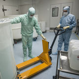 Staff working in clean area in the production site of the biotechnology company. ST. PETERSBURG, RUSSIA - NOVEMBER 16, 2016: Staff working in clean area in the stock photo