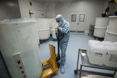 Staff working in clean area in the production site of the biotechnology company. ST. PETERSBURG, RUSSIA - NOVEMBER 16, 2016: Staff working in clean area in the stock image