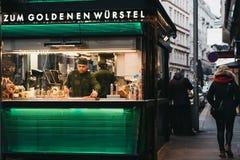 Staff working at the Zum Goldenen Wursten `The Golden Sausages` stand in Vienna, Austria. stock photography