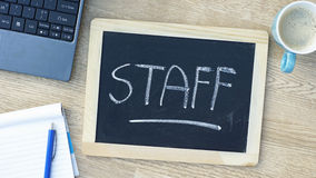 Staff written. On a chalkboard at the office Royalty Free Stock Photos