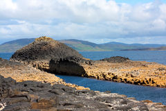 Staffa, Scotland. Rocky island, Staffa on sunny Summer day Stock Images