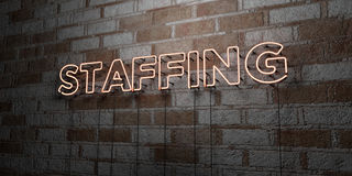 STAFFING - Glowing Neon Sign on stonework wall - 3D rendered royalty free stock illustration. Can be used for online banner ads and direct mailers Royalty Free Stock Photo