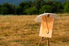 Staffli med paraplyet Arkivfoton