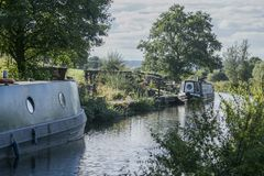 Staffordshire; British countryside on a sunny day; barges ona a canal. stock photo