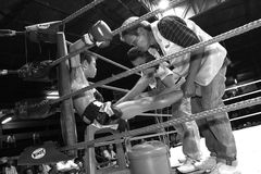 Staffs of boxing team take care of young Thai boxer Stock Images