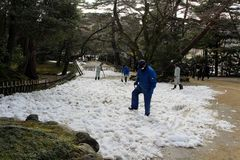 Staffs using shovel to clean some heavy snow covering Kenrokuen. Garden. Taken in Kanazawa, February 2018 Stock Photo