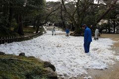 Staffs using shovel to clean some heavy snow covering Kenrokuen. Garden. Taken in Kanazawa, February 2018 Royalty Free Stock Photo