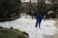 Staffs using shovel to clean some heavy snow covering Kenrokuen. Garden. Taken in Kanazawa, February 2018 Royalty Free Stock Photos