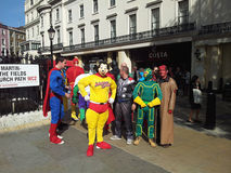 Stag night. Group of guys dressed as a super heroes are getting ready for a stag night out in London