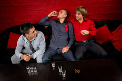 Stag party. Men drinking shots in night club Stock Photo