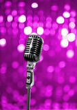 On stage. Retro microphone on purple stage Stock Photography
