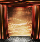 Stage. A stage with a wooden floor and cloudy sun set backdrop stock image