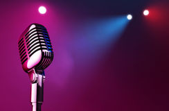 On Stage. 50s mic over stage light background Royalty Free Stock Image