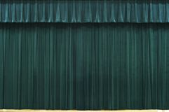 Stage. Big pretty green curtains on stage Stock Images