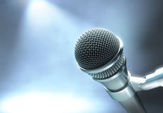 On Stage. Modern microphone on a stage with lights for live performance Stock Image