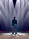 Stage. An actor is standing in spotlights on a stage Royalty Free Stock Image