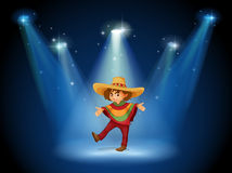 A stage with an actor at the center Stock Image