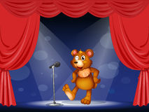 A stage with a bear performing Stock Photography