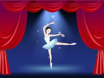 A stage with a beautiful ballerina dancer Stock Photography