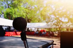 Stage black microphone, dark, natural background, blurred royalty free stock images
