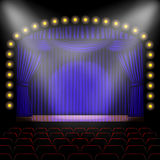 Stage with blue curtain Royalty Free Stock Photo
