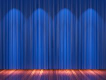 Stage with blue  curtains and spotlight. Stock Photos
