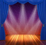 Stage with blue  curtains and spotlight. Stock Image