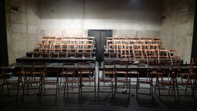 Stage with chairs. Empty stage with lot of wooden chairs Stock Image