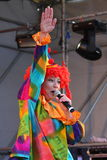 On stage children's clown entertainer. Stock Image