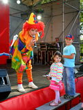 On stage children's clown entertainer. Royalty Free Stock Image