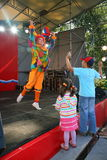 On stage children's clown entertainer. Royalty Free Stock Photo