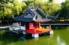 Stage for chinese village. People take boat to watch Chinese opera Royalty Free Stock Photography