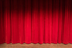 Stage With Closed Red Curtains. Wood stage with closed red curtains with shadow at the top Royalty Free Stock Images