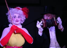 On stage, clowns, mimes, comedians, actors of the troupe of mime theatre mime and clowning, the Licedei. Clown Anna Orlova and clown Robert Gorodetsky perform stock photography