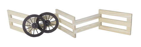 Stage Coach Wheels Against Wooden Fence Royalty Free Stock Image