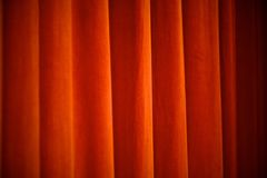 Stage Curtain. Stage lights warm up this theater curtain stock images
