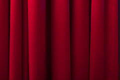 Stage curtain. Red theatre stage curtain. Closeup photo with soft lighting. Full frame stock image