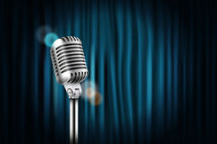Stage curtains with shining microphone Royalty Free Stock Image