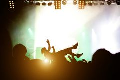 Stage diving. Crowd surfing during a musical performance royalty free stock image