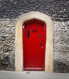 Stage door. Ancient wooden door in a stone wall, painted red and with the words Stage Door Stock Photography