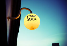 Stage door light at dusk. Illuminated theatre stage door at dusk Royalty Free Stock Photos